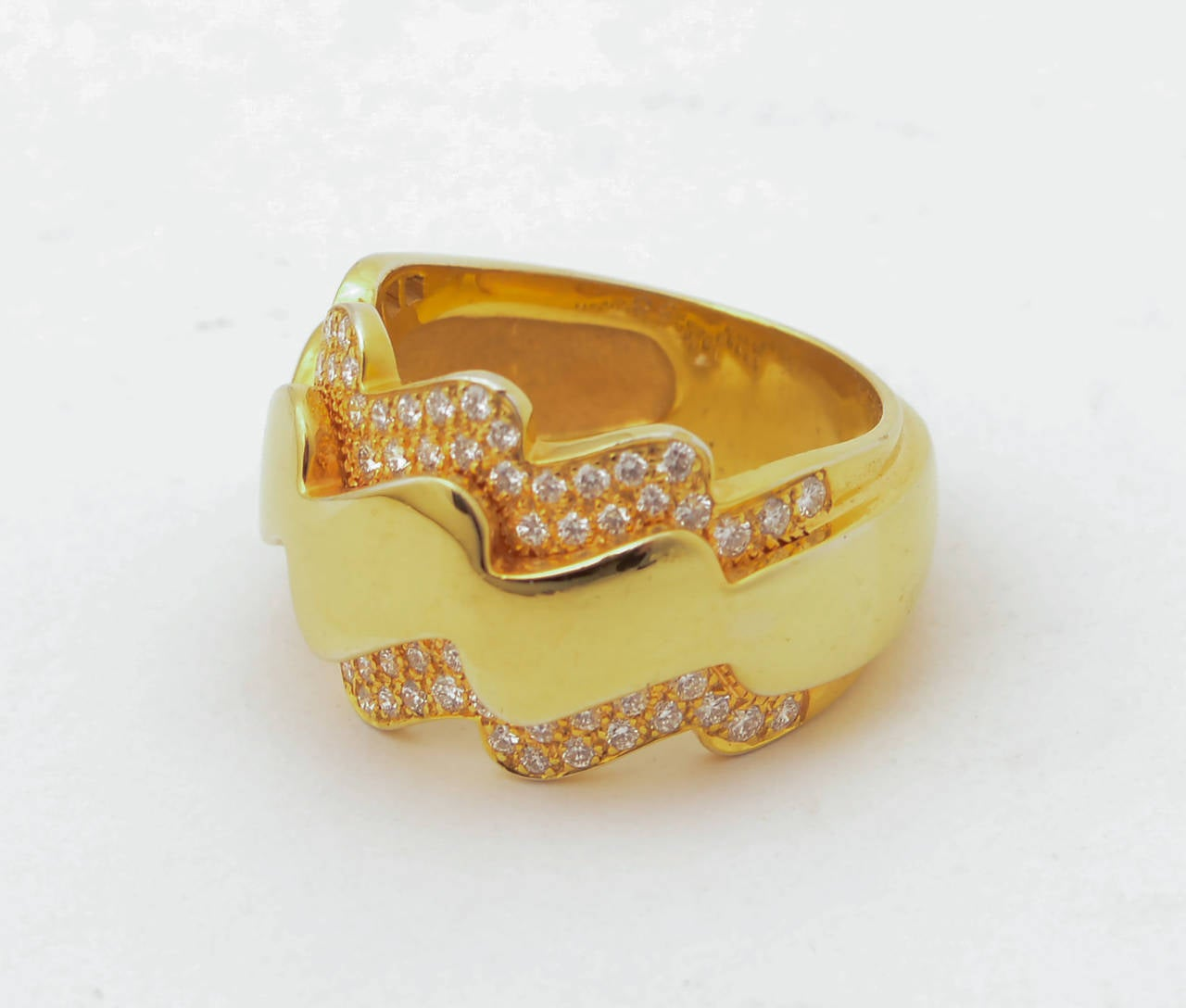 Van Cleef & Arpels zig zag band ring that matches earrings item  LU133338302. Made of 18 karat gold and diamonds. Ring is size 8 but can be sized. The front is 5/8