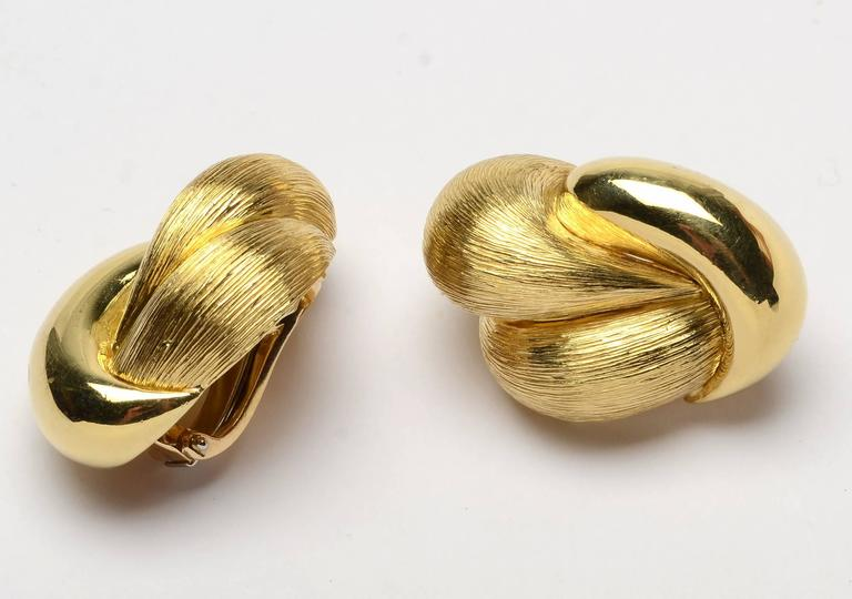 These voluptuous lobed earrings by Henry Dunay are made with both his brushed Sabi finish as well as a high gloss. Clip backs can be converted to posts. The earrings measure 1 1/4