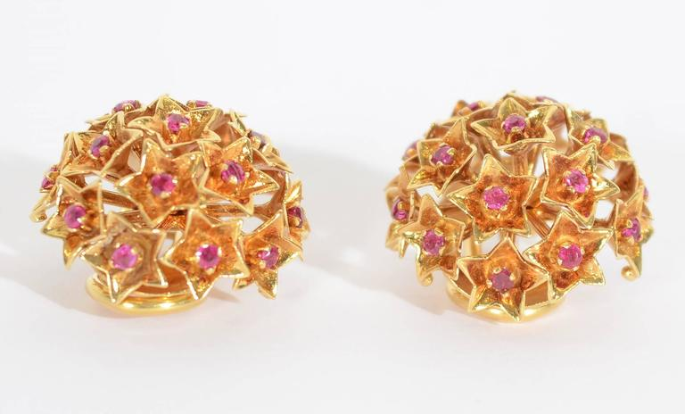 Dome shaped earrings by Tiffany and Co. in which rubies are set in five point stars. They measure 3/4