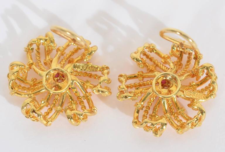 Tiffany & Co. Ruby Diamond Gold Swirling Star Earrings  In Excellent Condition For Sale In Darnestown, MD