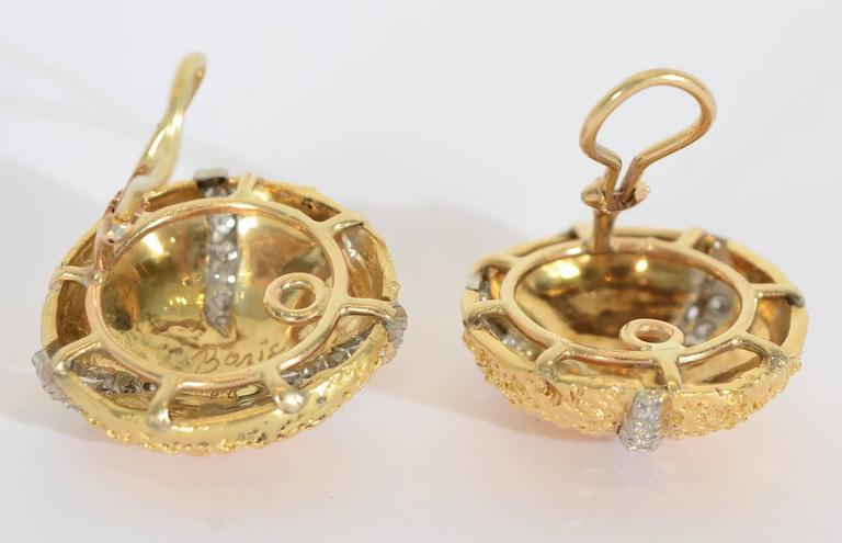 Wonderfully textured earrings by the late jewelry designer and sculptor, Boris Le Beau. LeBeau had a store on Madison Avenue for many years. These earrings measure 1 inch in diameter. In addition to the finely sculpted texture, each earring has