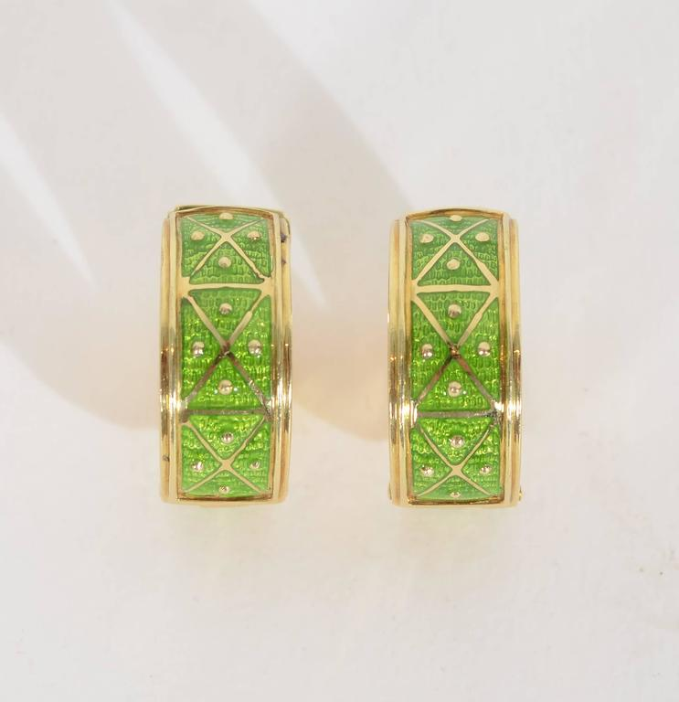 Chic and casual gold and enamel hoop earrings by Sabbadini. X's and dots of gold are repeated in six panels. They measure 7/8
