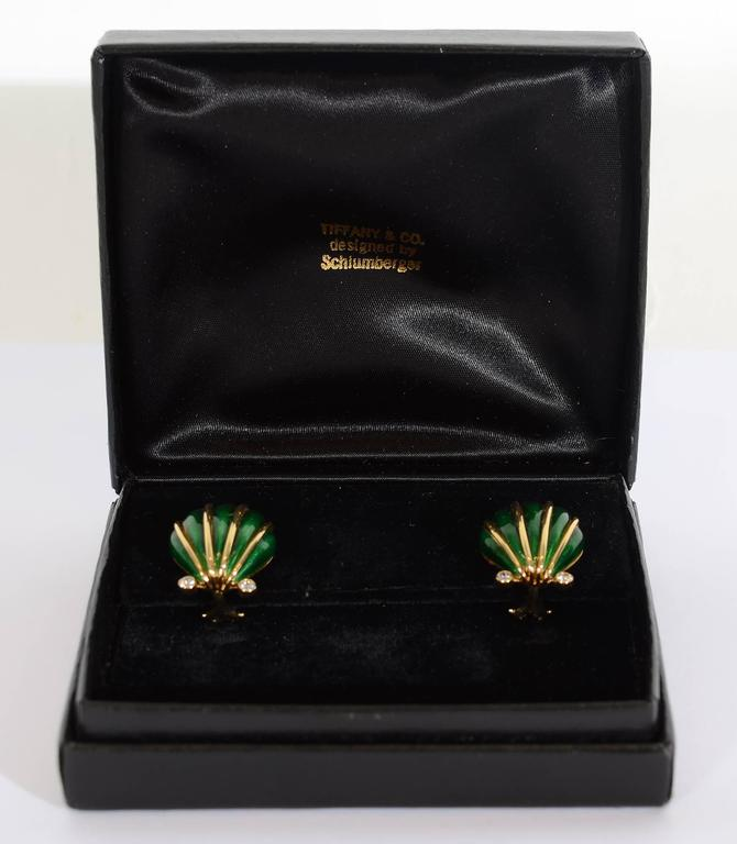 "The addition of diamonds makes these Schlumberger enamel shell earrings dressier than usual. Measurements are 13/16"" long and 3/4"" wide. Backs are posts and clips. Excellent condition."