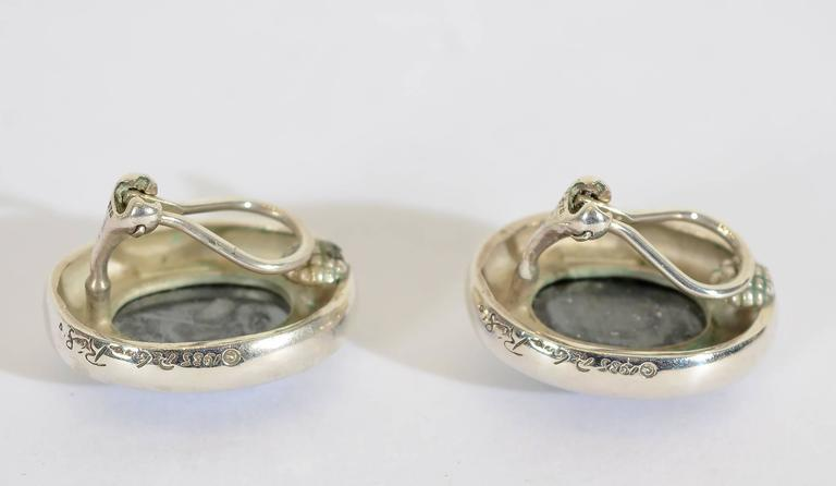 Bold and striking silver earrings with hematite by Pablo Picasso's youngest daughter, Paloma. They are signed Paloma Picasso and dated 1985. The earrings measure 1 inch in length and 3/4 inch in width. Clip backs can be converted to posts; excellent