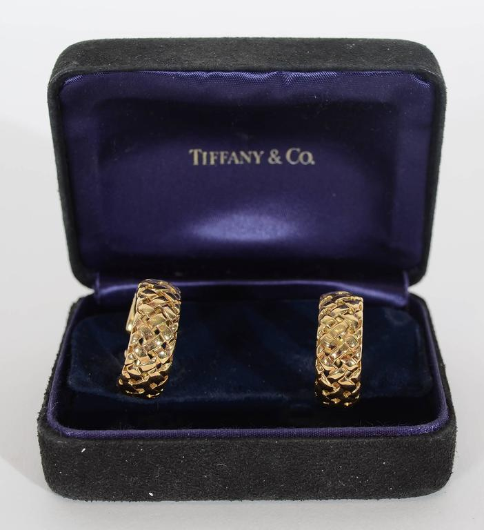 """Basketweave hoop earrings made by Tiffany in 18 karat gold. Dated 1995. Post and clip backs. Measure 3/4"""" in diameter. These are the most wearable of earrings. Sold in the original Tiffany box."""