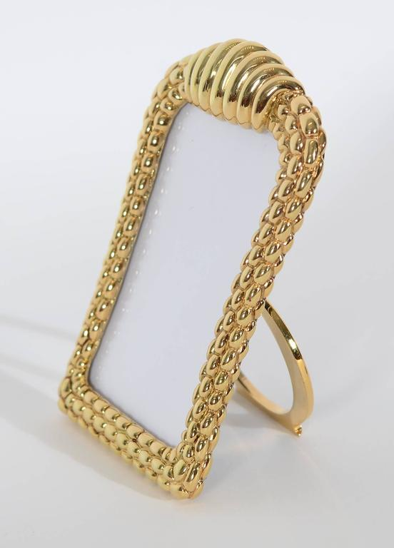 How better to remember a special  person or event than in this elegant gold picture frame by Fope Gioielli?  Fope has been creating fine jewelry in Venice since 1929. The sculptural design of this frame is much like the link bracelets for which they
