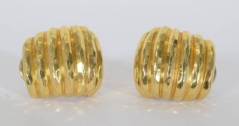 Henry Dunay hammered gold and ribbed earrings. They are half hoops as shown in thumbnail photo. Backs are posts and clips. They are 13/16
