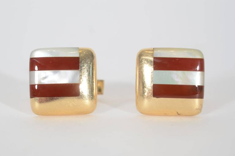 Carnelian and mother of pearl cufflinks by Asch Grossbardt. Two sides of the stones are surrounded by a right angle of gold making an interesting geometric pattern.