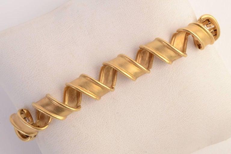 Modern Tiffany & Co. Gold Ribbon Bracelet For Sale