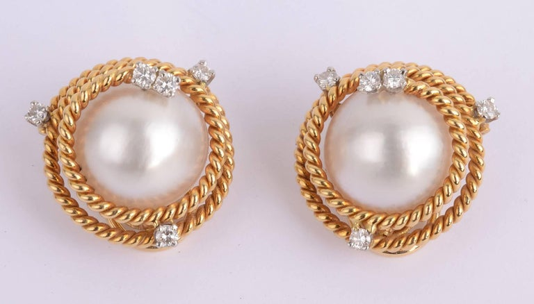 a6cf624a1 Pair of gold and mabé pearl and diamond earclips by Jean Schlumberger for  Tiffany &