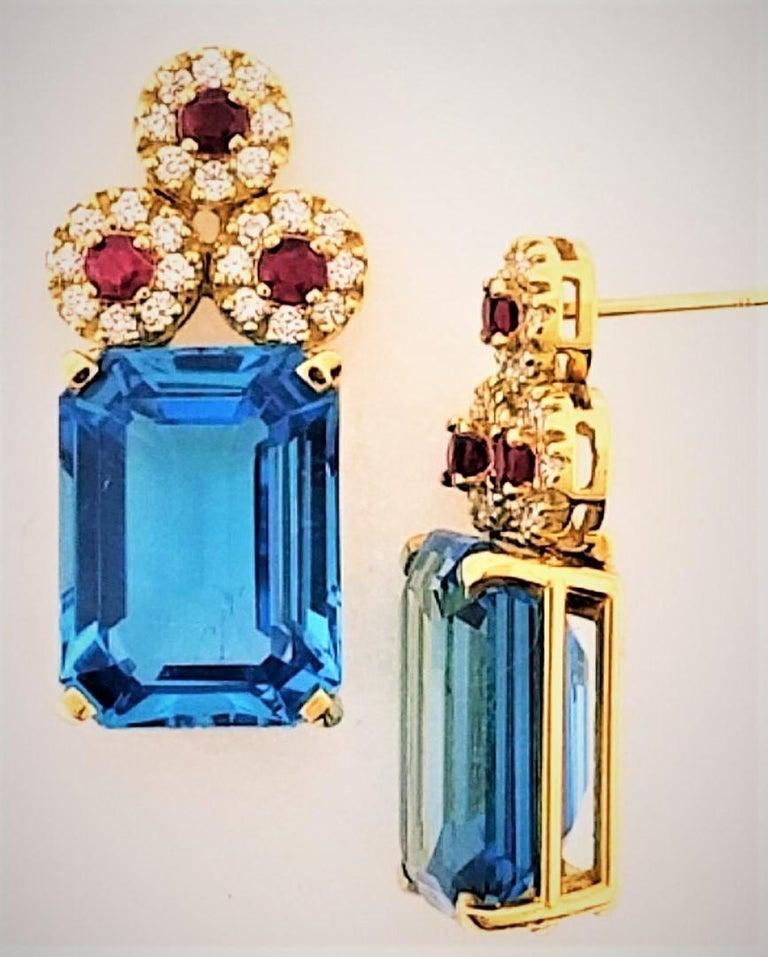 Contemporary 18 Karat Yellow Gold, Blue Topaz '28.51 Carat', Ruby '0.83 Carat', Earrings For Sale