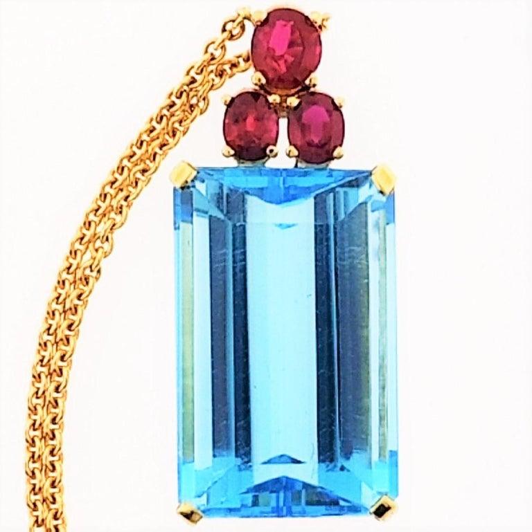 Emerald Cut 18 Karat Yellow Gold, Blue Topaz '28.51 Carat', Ruby '0.83 Carat', Earrings For Sale