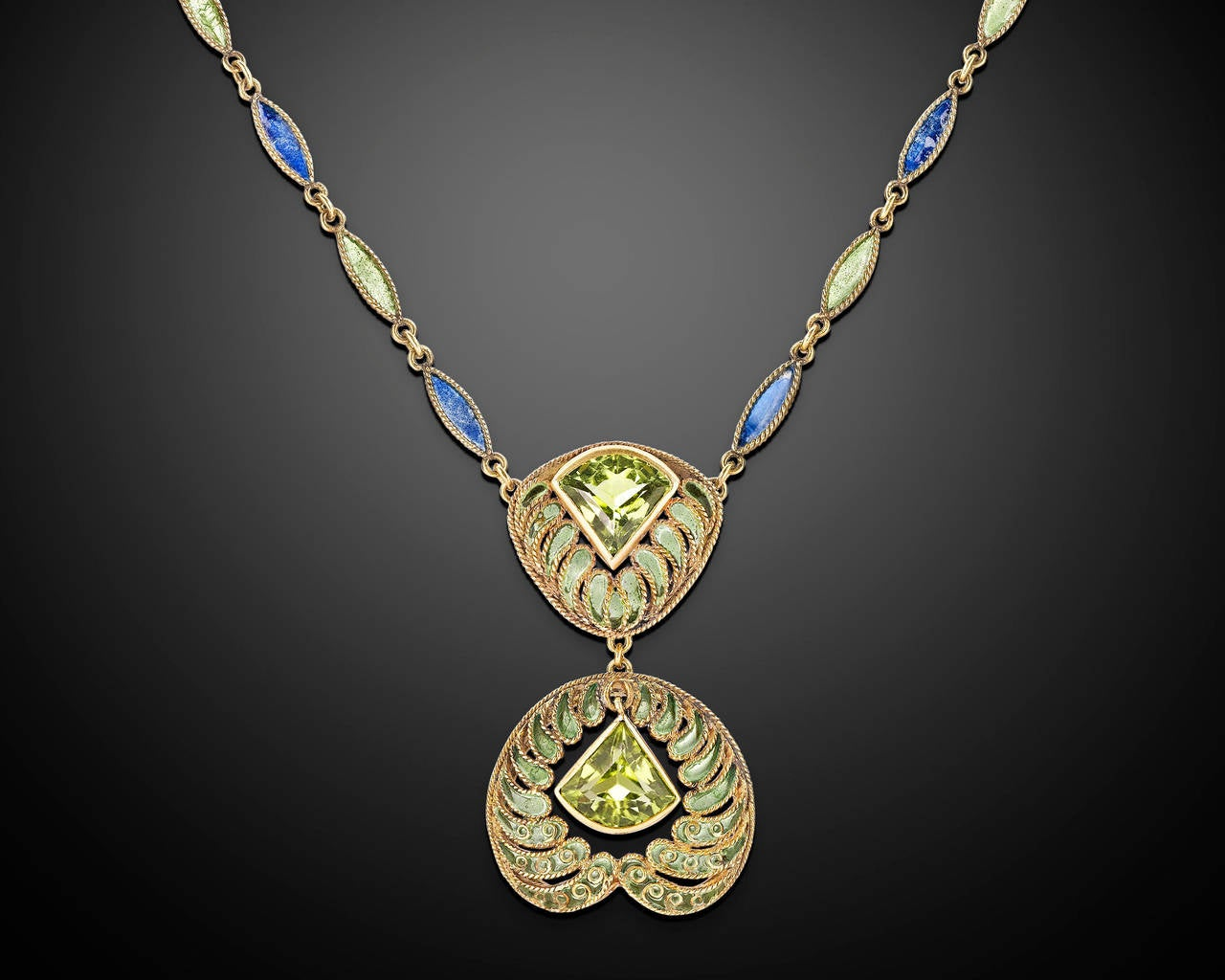 Crafted by the legendary artist and designer Louis Comfort Tiffany for Tiffany & Co., this extraordinary peridot and plique-à-jour enamel necklace is a rare and unique masterpiece of jewelry design. Delicately crafted, the necklace boasts finely