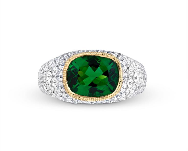A rare 2.55-carat chrome tourmaline is on display in this breathtaking and bold ring. The extraordinary stone exhibits a refreshing and brilliant green hue that is far more dazzling than the typical green tourmaline. This is due to the stone's