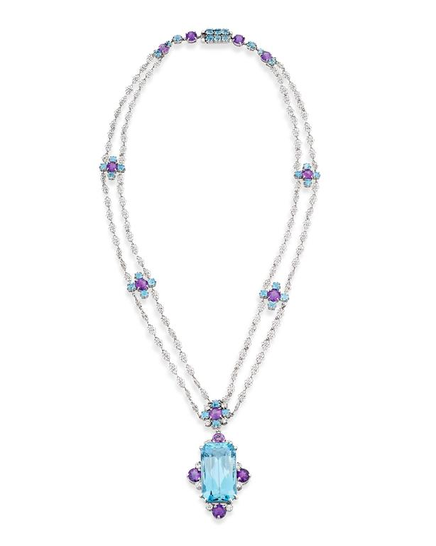 Crafted by the legendary Tiffany Studios and retailed by Tiffany & Co., this extraordinary aquamarine and amethyst necklace is a rare and unique masterpiece of jewelry design. A large faceted aquamarine weighing approximately 12.00 carats is the