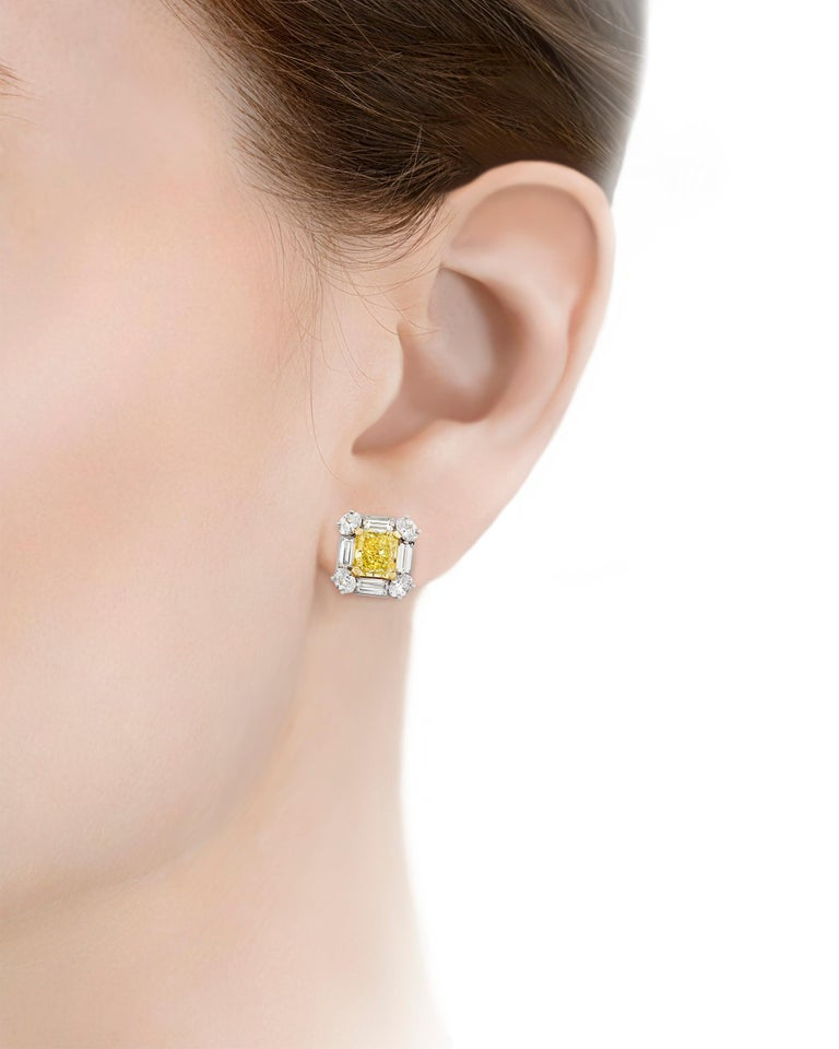These fancy intense yellow diamond earrings reflect elegance at its most brilliant. Weighing 2.08 carats and 2.10 carats, the remarkably rare gems possess the radiant, highly saturated lemon yellow for which fancy intense yellow diamonds are