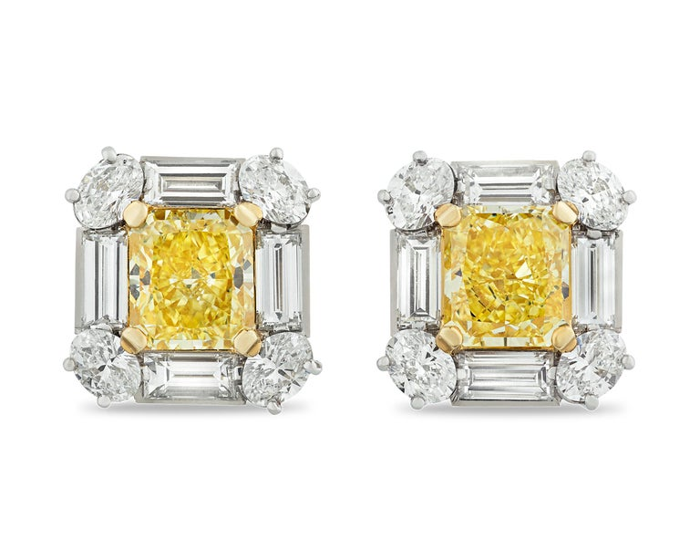 Contemporary Fancy Intense Yellow Diamond Earrings, 4.18 Carat For Sale