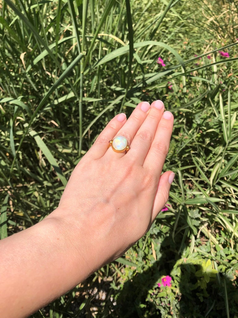 Oval Cut Scrives White Opal and Rubies 22 Karat Gold Ring For Sale