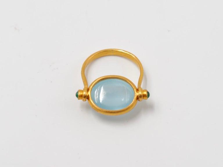 Oval Cut Scrives Aquamarine Emerald Cabochon 22 Karat Gold Turning Ring For Sale