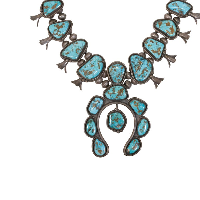 23 stone squash blossom necklace. The turquoise is from the Morenci Mine in Arizona. Eight stone naja with fifteen stone rope. Exceptional.  PERIOD: After 1950  ORIGIN: Navajo, Southwest  SIZE: Length: 32 1/8