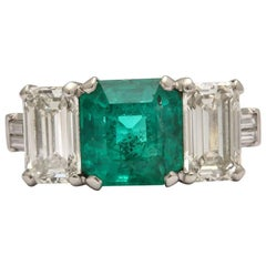 Art Deco Emerald and Diamond 3-Stone Ring Set in Platinum