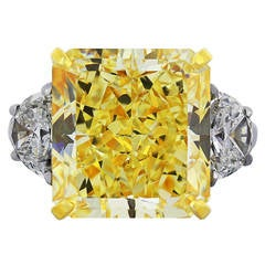 GIA Certified 14.63 Carat Fancy Yellow Diamond Three Stone Engagement Ring