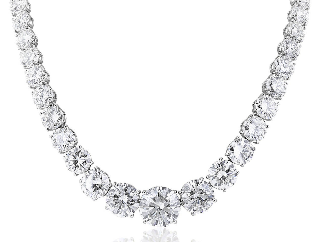 Stunning Platinum graduated Diamond Riviera style necklace.  The neclklace features 59 round brilliant cut diamonds having a total weight of 77.05 carats. three of the diamonds have GIA certificates.