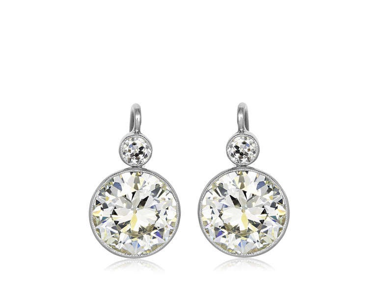 Platinum And 18 Karat Yellow Gold Bezel Set Vintage Style Drop Earrings Consisting Of 2 Old