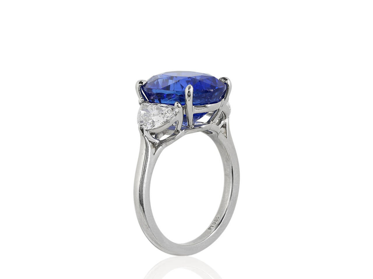 Platinum custom made 3 stone ring consisting of one oval shaped blue sapphire weighing 8.46 carats with Tokyo gem lab certificate #24070332 stating No Heat, the center stone is flanked by 2 brilliant cut half moon diamonds having a total weight of