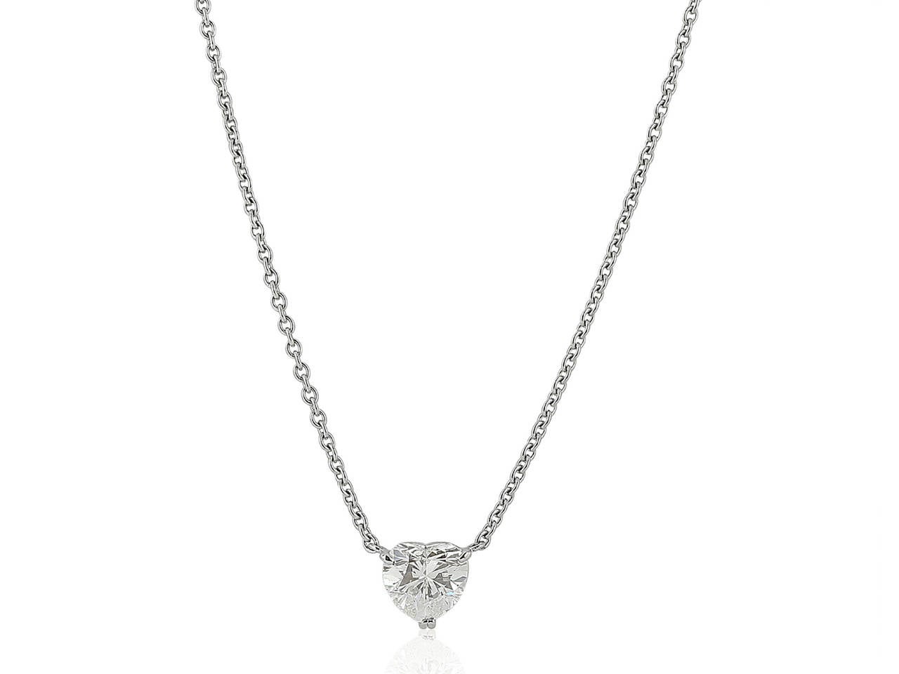 Platinum pendant consisting of one prong set heart shape diamond weighing 1.89 carats having a color and clarity of H/SI1 respectively.