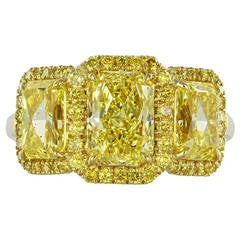 Fancy Intense GIA Certified Yellow Diamond Gold Three-Stone Engagement Ring