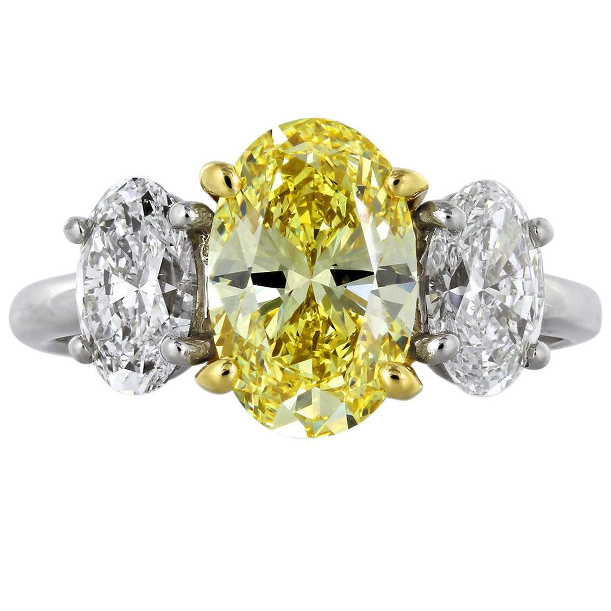 2.12 Carat Fancy Intense Yellow GIA Diamond Ring