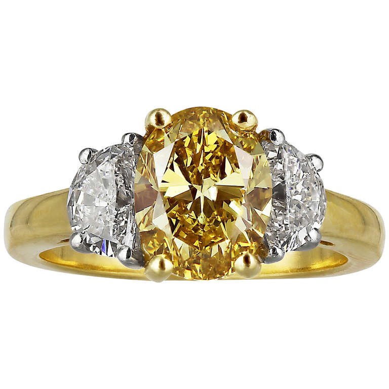 2 04 Carat Oval Shaped Canary Diamond Three Stone Ring at 1stdibs
