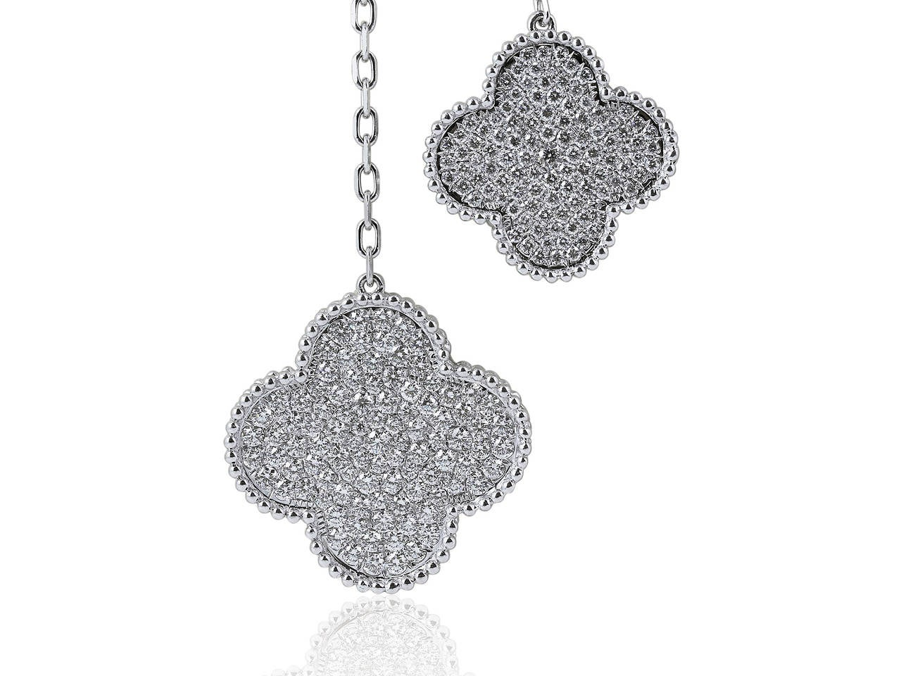 18 karat white gold Clover motif necklace consisting of 6.64 carats total weight of round brilliant cut diamonds.