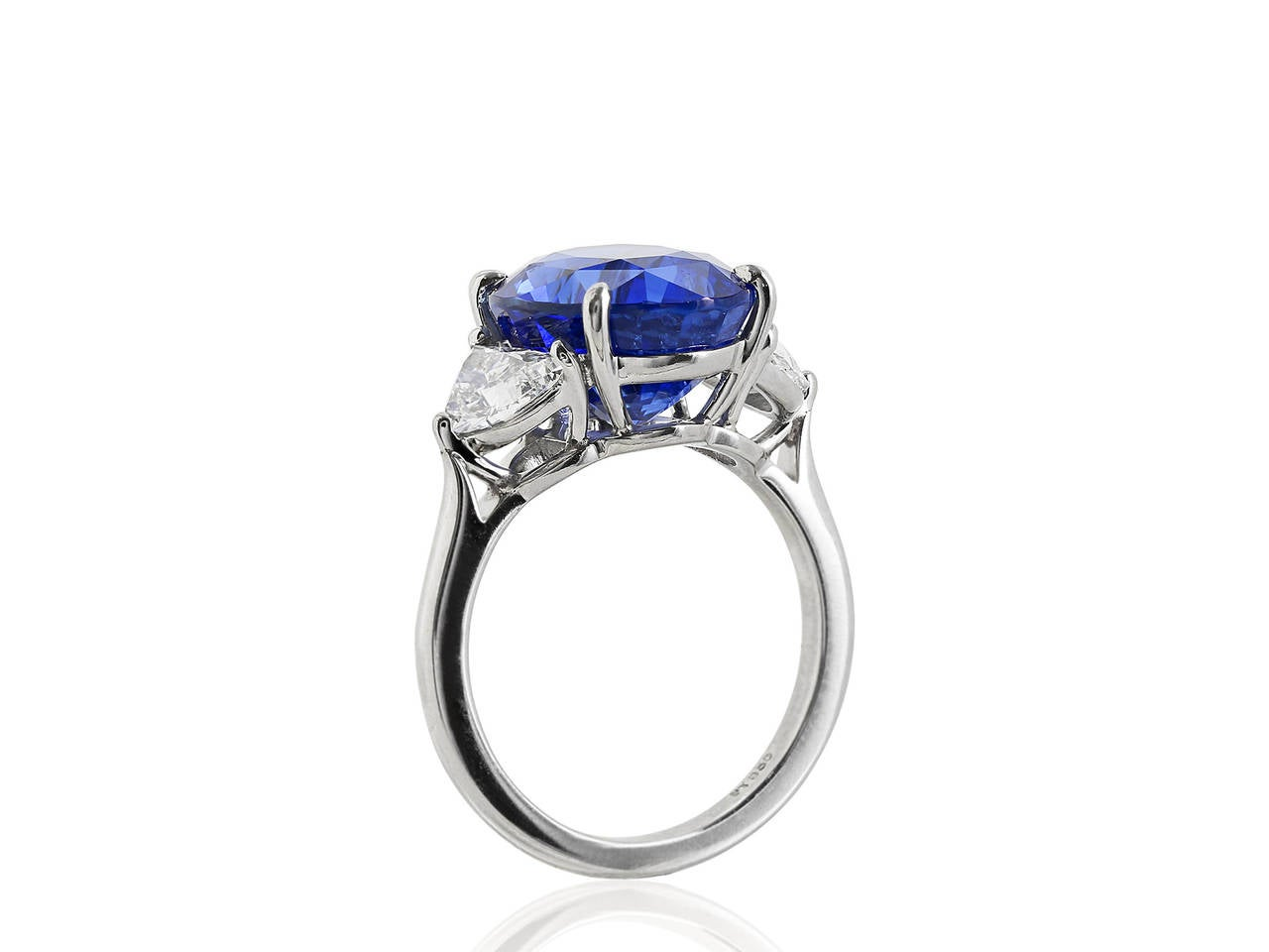 Platinum custom made 3 stone ring consisting of 1 oval shaped blue sapphire weighing 10.08 carats, with GIA certificate #1172210095 stating Royal Blue no heat, the center stone is flanked with 2 half moon shaped diamonds having a total weight of