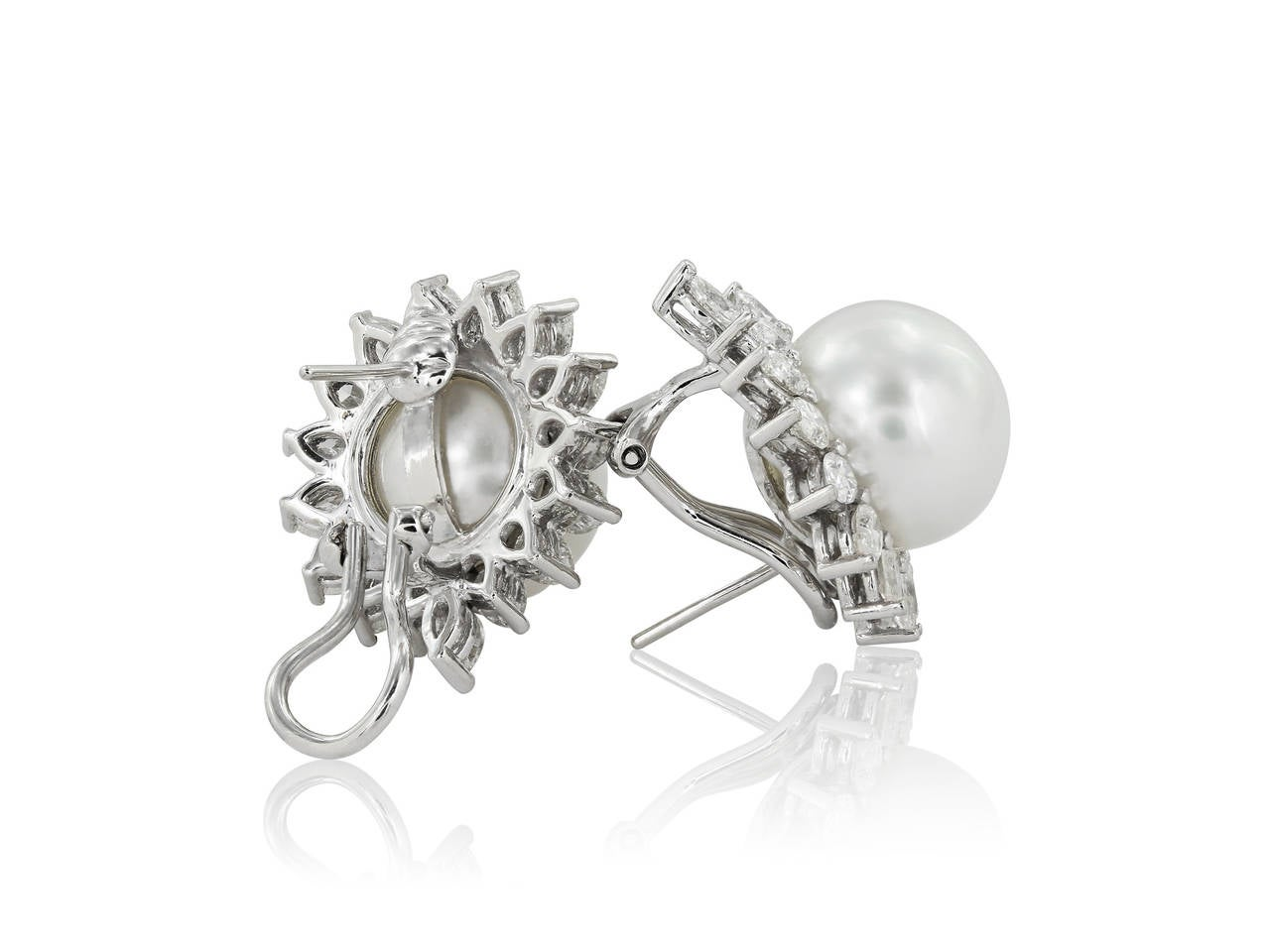 18 karat white gold earrings consisting of two 13mm south sea pearls surrounded by marquise shaped diamonds weighing 3.55 carats.
