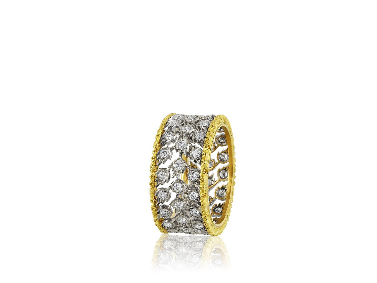 18 karat yellow and white gold Buccellati ring from the Milano collection. Ring features Round Brilliant Cut diamonds set on an open work setting weighing a total of 1.10 carats. Size 7.25.