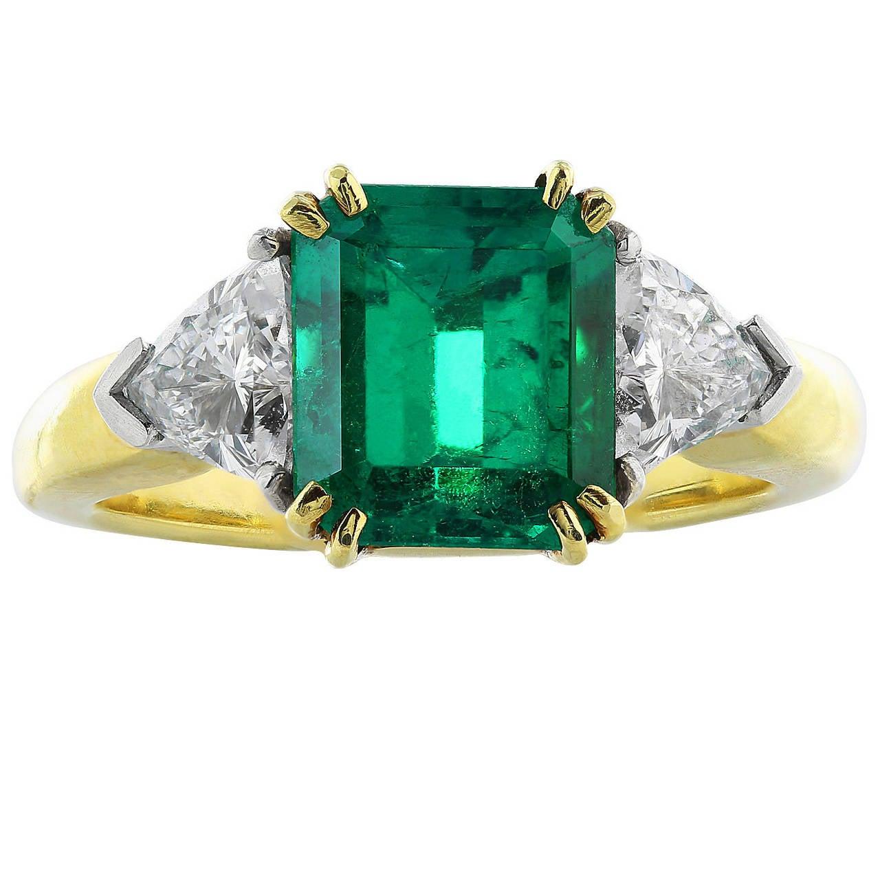2.47 Carat Emerald Diamond Gold Platinum Three Stone Ring