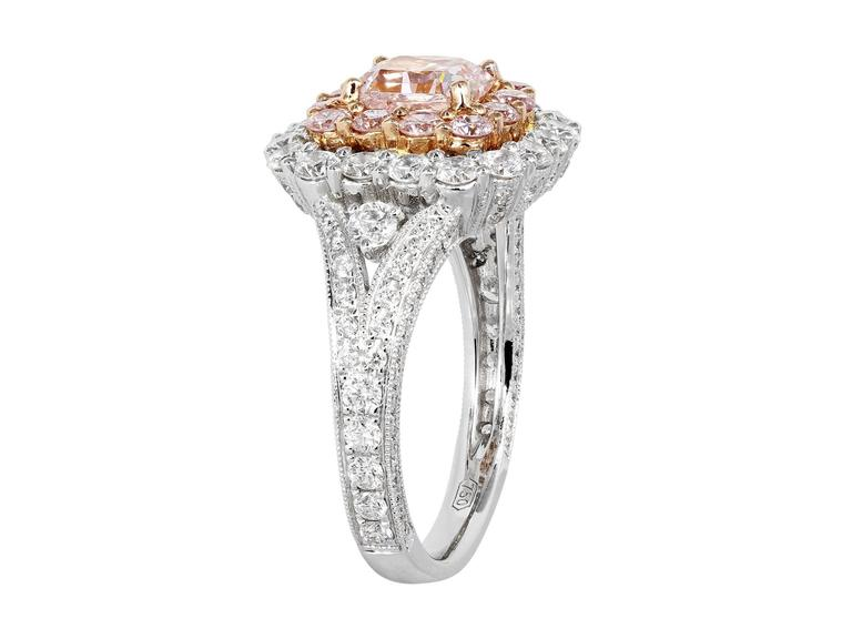 18 karat two tone white and rose gold halo style ring consisting of 1 radiant cut natural Fancy Light pink diamond weighing 1.00 carats, with GIA certificate #5121251462, the center stone is surrounded with a single row of full cut natural pink
