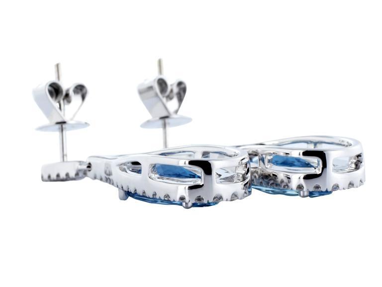 18 karat white gold drop earrings consisting of 2 marquise shape aquamarine having a total weight of 3.60 carats set with .98 carats total weight of round brilliant cut diamonds.