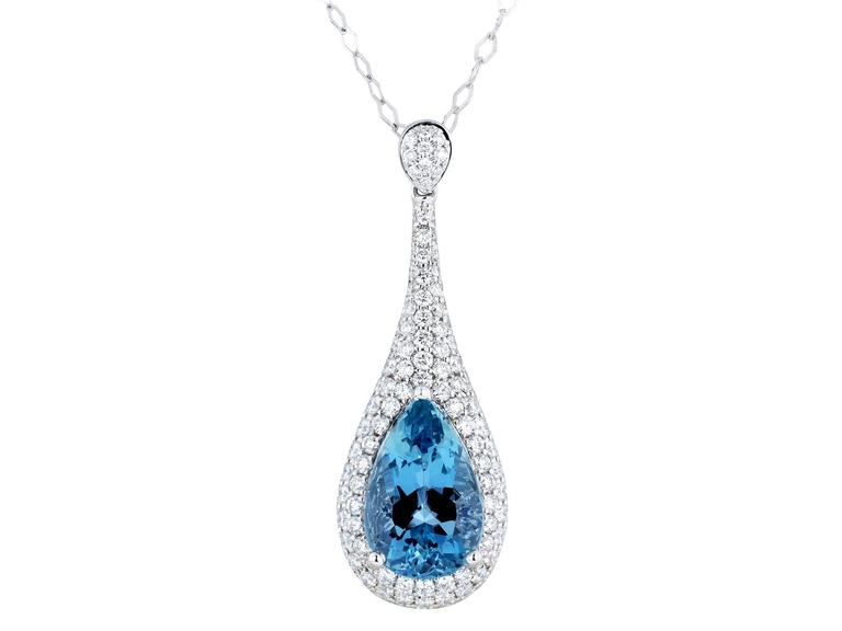 18 karat white gold drop pendant consisting of 1 pear shape aquamarine weighing 3.26 carats set with 1.20 carats total weight of round brilliant cut diamond accents.