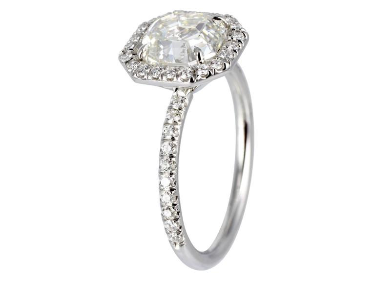 Platinum halo style ring consisting of 1 asscher cut diamond weighing 2.07 carats having a color and clarity of J/SI1, measuring 7.64 x 7.17 x 5.14mm with GIA certificate #16275340, the center stone is set with 42 round brilliant cut diamonds having