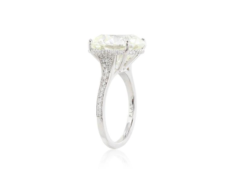 Platinum Diamond ring, featuring one 10.06cts. round brilliant cut diamond having a color and clarity of K/SI1 3X GIA cert# 2165357790 The diamond is set in a diamond mounting with an under gallery halo and diamonds on the band having a total weight