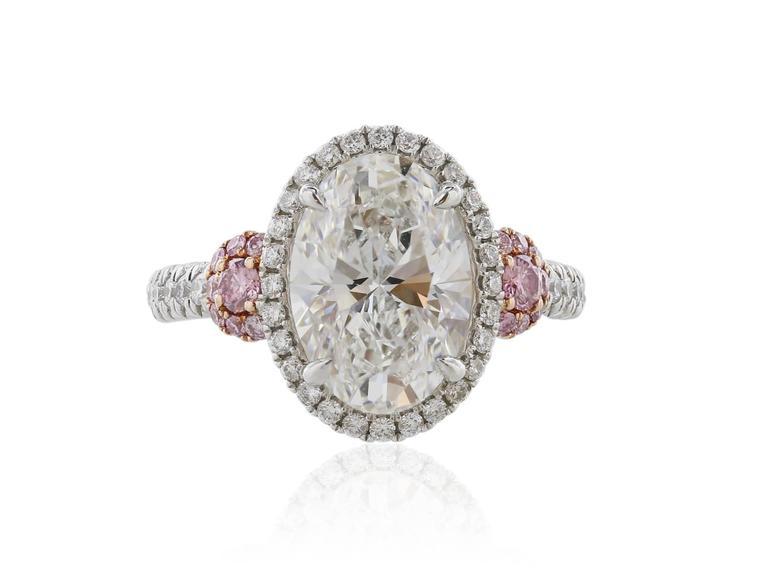 GIA Certified 3.01 Carat Oval Diamond Fancy Pink Diamond Platinum Ring 4