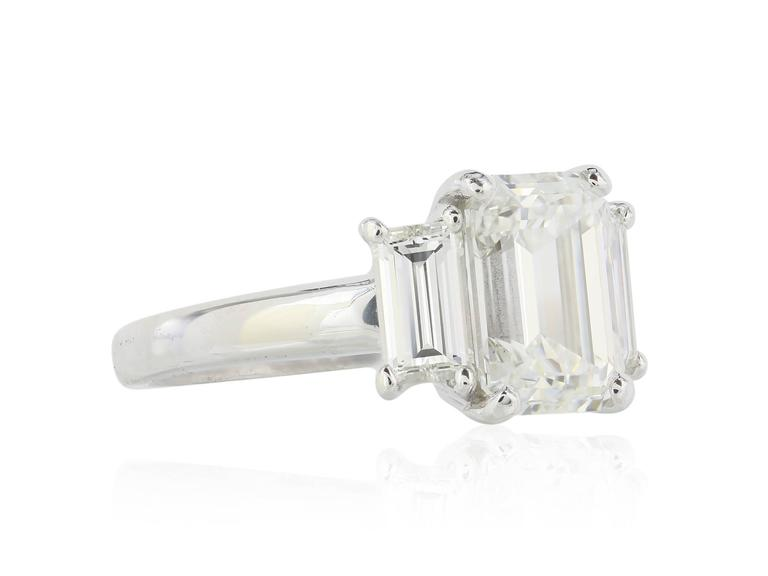 GIA Certified 3.01 Carat Emerald Cut Three Stone Diamond Engagement Ring In Excellent Condition For Sale In Chestnut Hill, MA