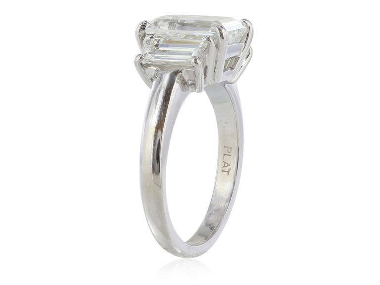 GIA Certified 3.01 Carat Emerald Cut Three Stone Diamond Engagement Ring For Sale 1