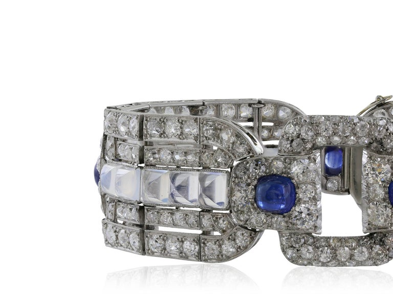 Platinum custom Art Deco bracelet consisting of Old European cut diamonds with an approximate weight of 15 carats set in intricate open work pattern, with 5 cabochon cut sapphires and 20 cabochon cut moonstones.