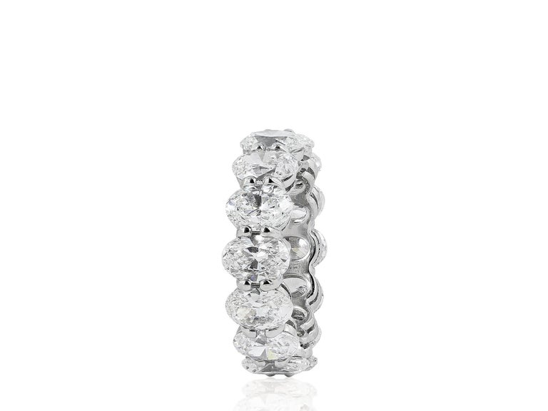 Platinum shared prong eternity band consisting of 14 oval shaped bands having a total weight of 10.03 carats having a color and clarity of G/VS2 respectively.