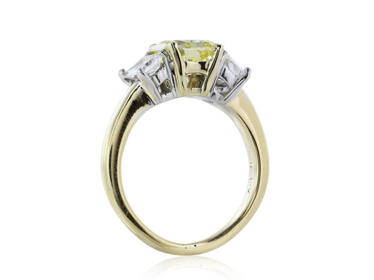 1.66 Carat Fancy Yellow Diamond Three-Stone Ring In Excellent Condition For Sale In Chestnut Hill, MA