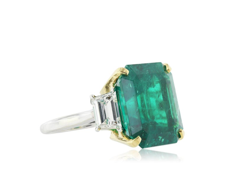 Shreve, Crump & Low''s custom made 18 karat yellow gold and platinum custom made Fine Colombian Emerald and diamond three stone engagement ring. Consisting of one square cut Emerald weighing 16.11 carats AGL #1084849 Colombian Minor oil and diamond